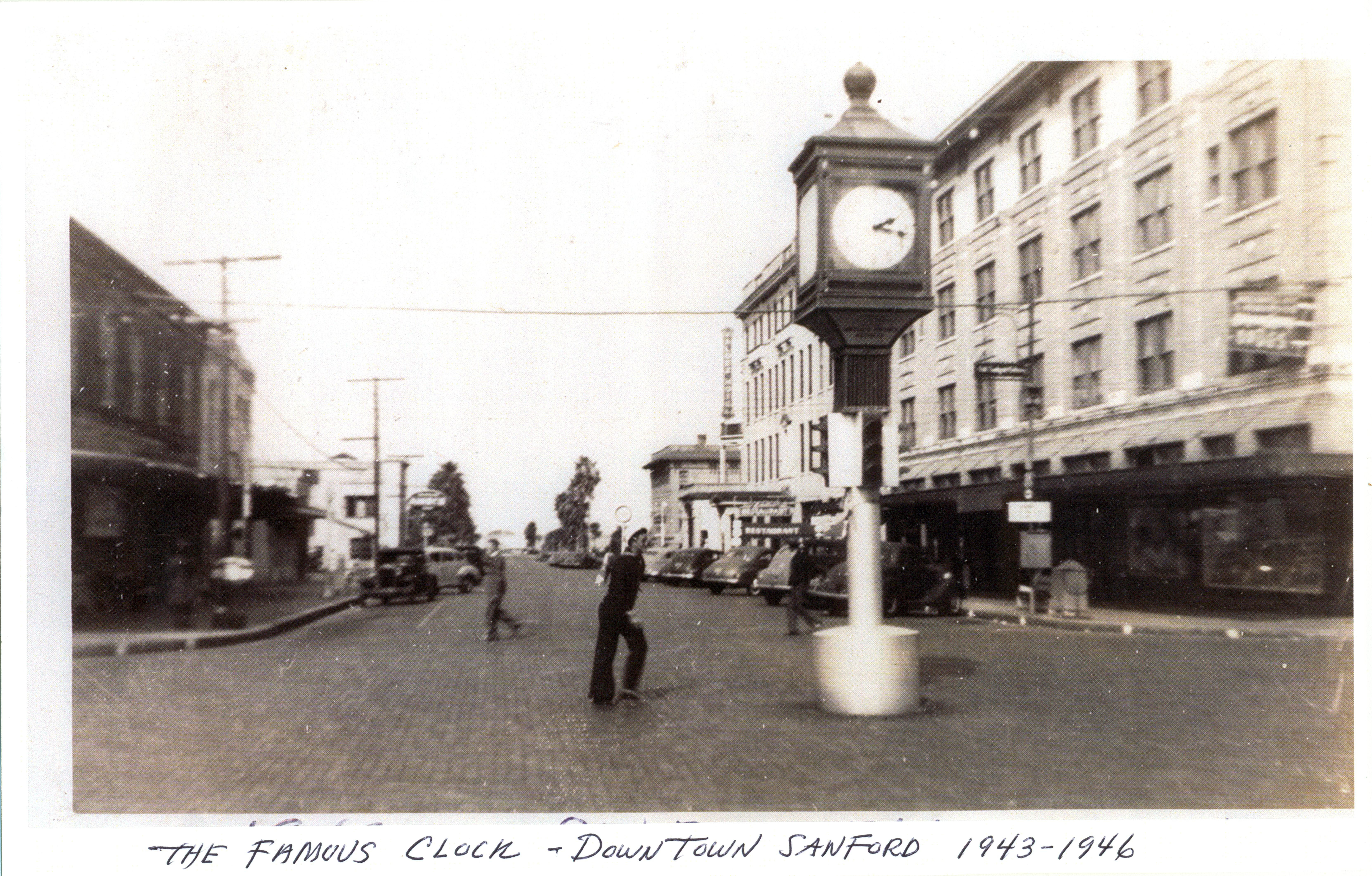 sailor walking by the historic clock in downtown sanford florida at the time that the photograph was taken the clock was located at the intersection of