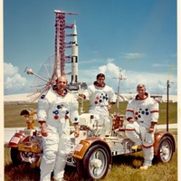 Apollo 17 Crew with Lunar Rover Trainer and Saturn V