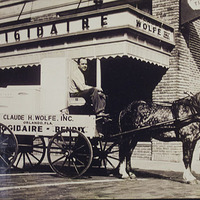 Claude H. Wolfe, Inc. Buggy in Front of the Frigidaire Store