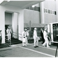 Apollo 7 Astronauts Boarding a Transfer Van