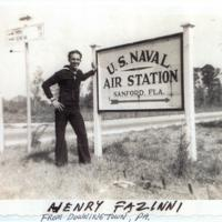 Henry Fazinni Next to Naval Air Station Sanford Sign