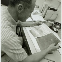 Apollo 11 Astronaut Buzz Aldrin Examining Lunar Surface Photographs